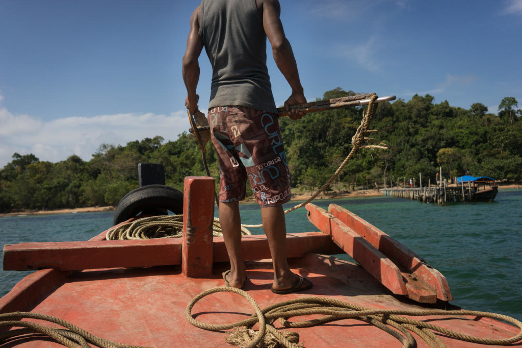 January 17, 2016- Cambodia. Nany prepares for the boat arriving to Koh Seh island, where Marine Conservation Cambodia is based. © Charlotte Pert