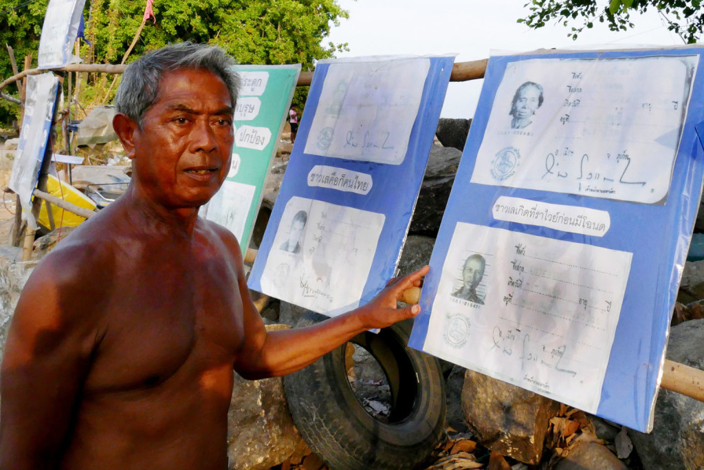 nifield23 - 71 year old Urak Lawoi community leader Ngim Damrongkaset and old pictures of the earliest Urak Lawoi to get Thai IDs. At Rawai beach, Phuket, Thailand##########Nil##########NIRMAL GHOSH