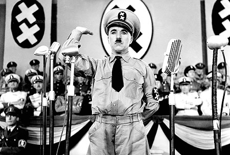 "085007_1.tif. ** FILE **Legendary silent film actor/director Charlie Chaplin is shown in a scene from the 1940 film ""The Great Dictator,"" his first film with dialogue, in this promotional photo. Chaplin plays the dual roles of a sweet-natured Jewish barber and a murderous Hitler-type dThe Great Dictator (AP Photo/The Roy Export Company Establishment, HO)"